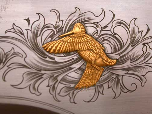 A woodcock inlaid in gold!