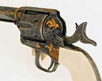 A Colt with many gold inlays.